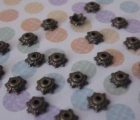 Tibetan Tiny Antique Bronze Bead Caps (24)